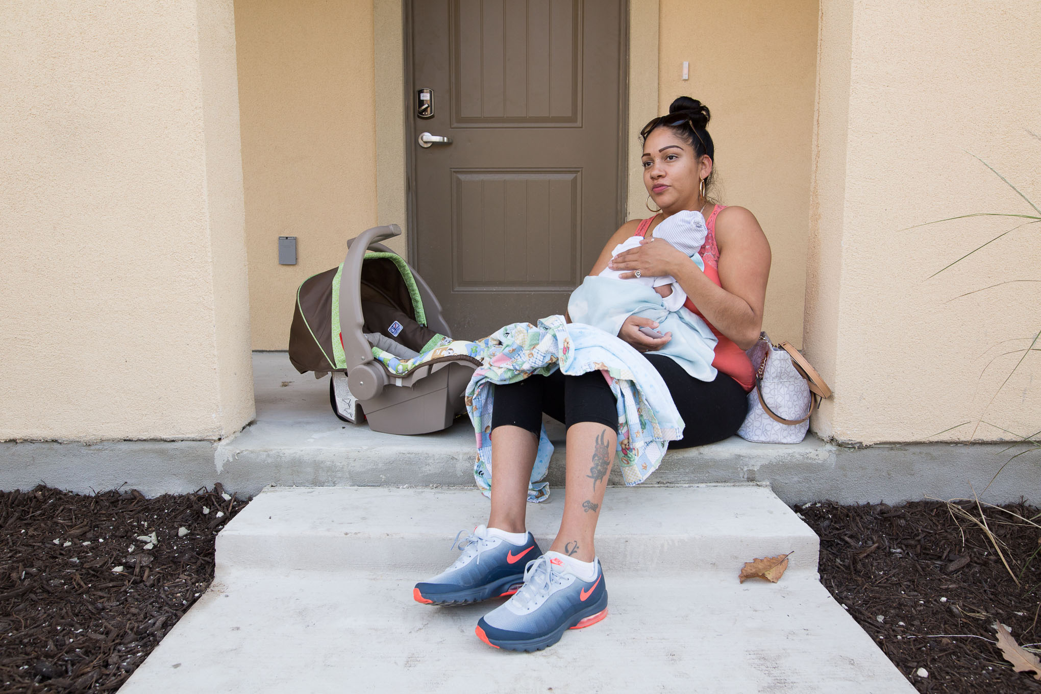 """Crystal Romo and her two week old son Jace Noel will be moving into East Meadows within the month and are currently living in a housing project nearby. """"I think it's going to be better because it's mixed instead of housing, housing is usually louder."""""""