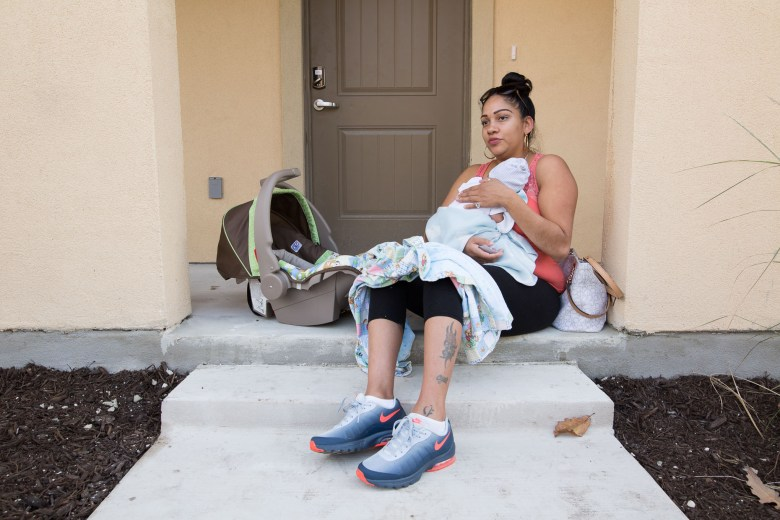 "Crystal Romo and her two week old son Jace Noel will be moving into East Meadows within the month and are currently living in a housing project nearby. ""I think it's going to be better because it's mixed instead of housing, housing is usually louder."""
