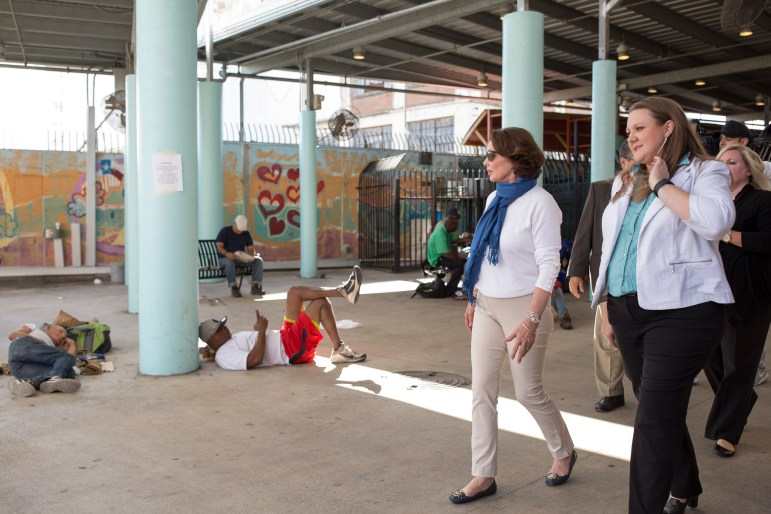 Patricia Barnes walks with Haven for Hope Director of Volunteer Services Melody Mcrea through the courtyard.