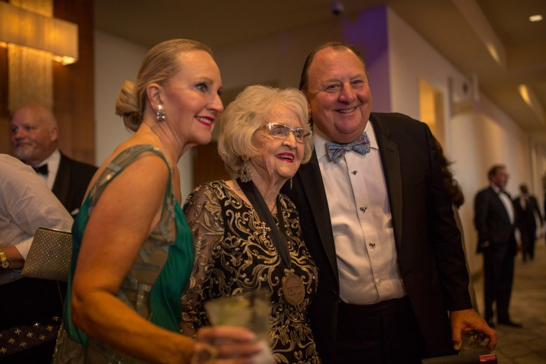 (center) Rosemary Kowalski takes a photograph with guests.