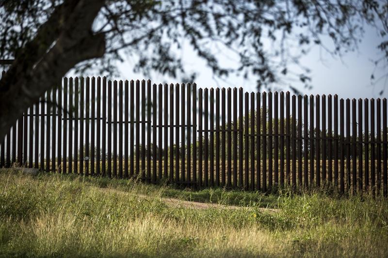 A border fence. Photo courtesy of the Texas Tribune.