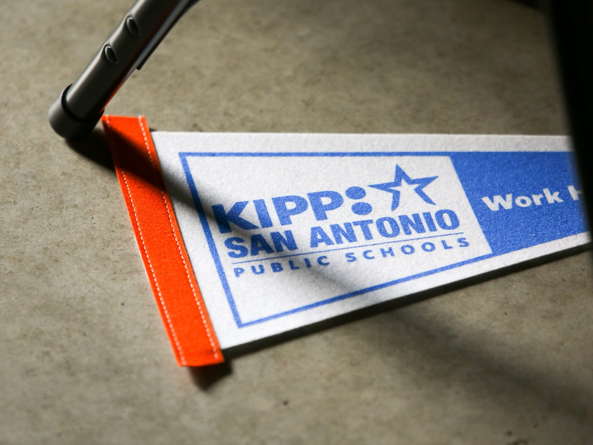 A penant flag of KIPP: San Antonio lays on the ground during the presentations. Photo by Scott Ball.