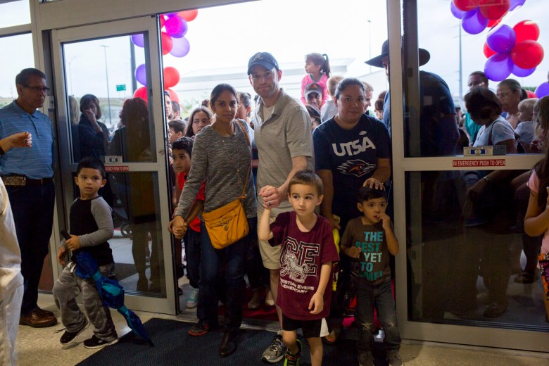 Families enter the new Mays Family YMCA.
