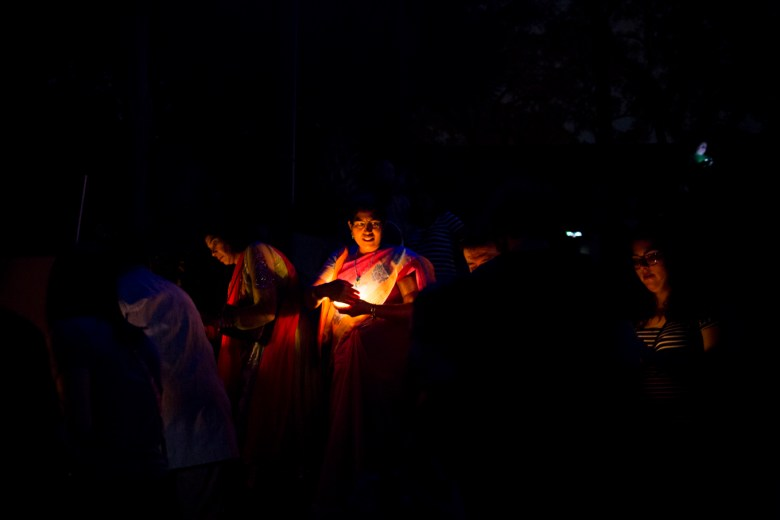 The Diyas, or floating candles, illuminate the faces of the Diwali Festival attendees.