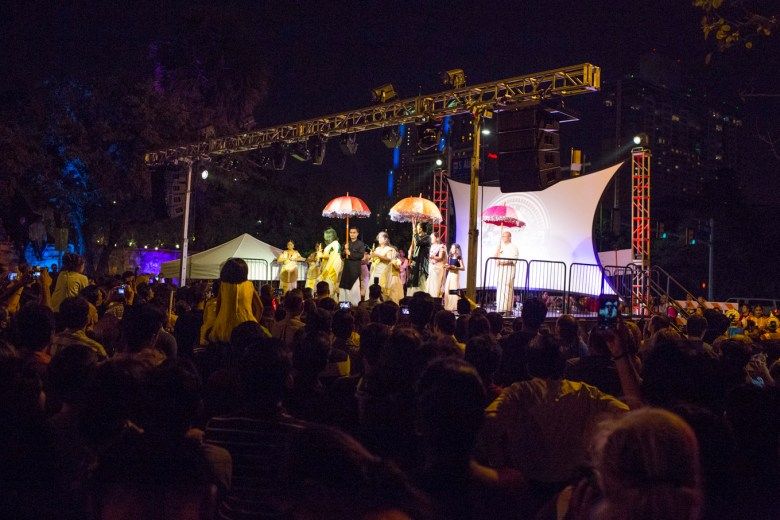 People crowd the stage to watch the Diwali Festival performances.