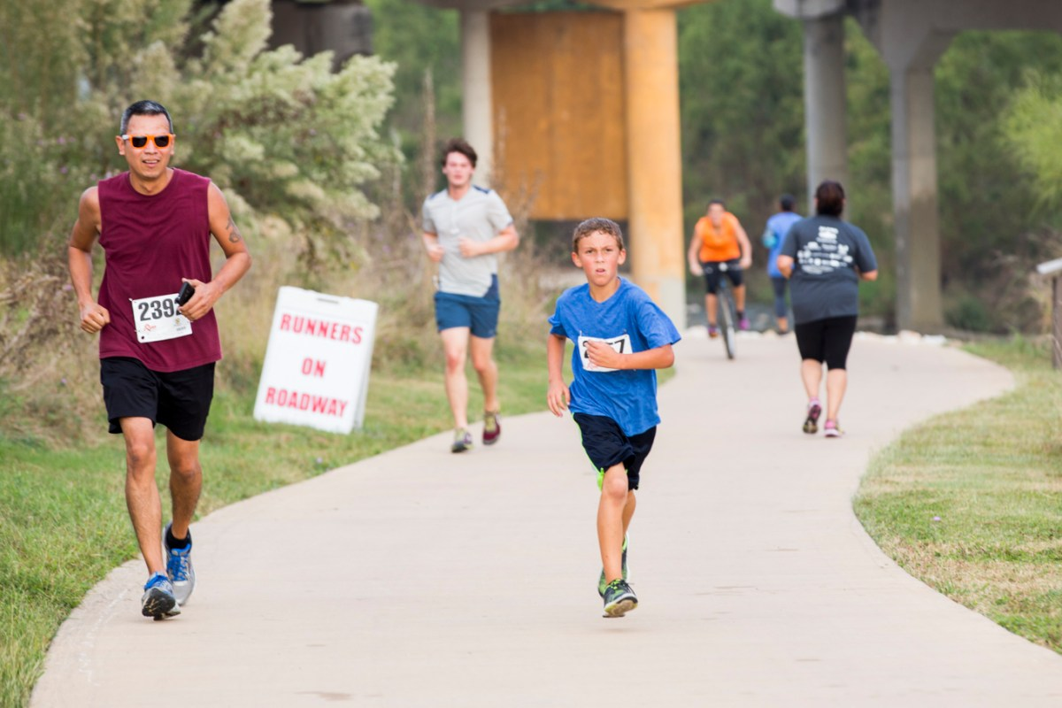 Runners charge up one of the many uphills along the Mission Reach trail.