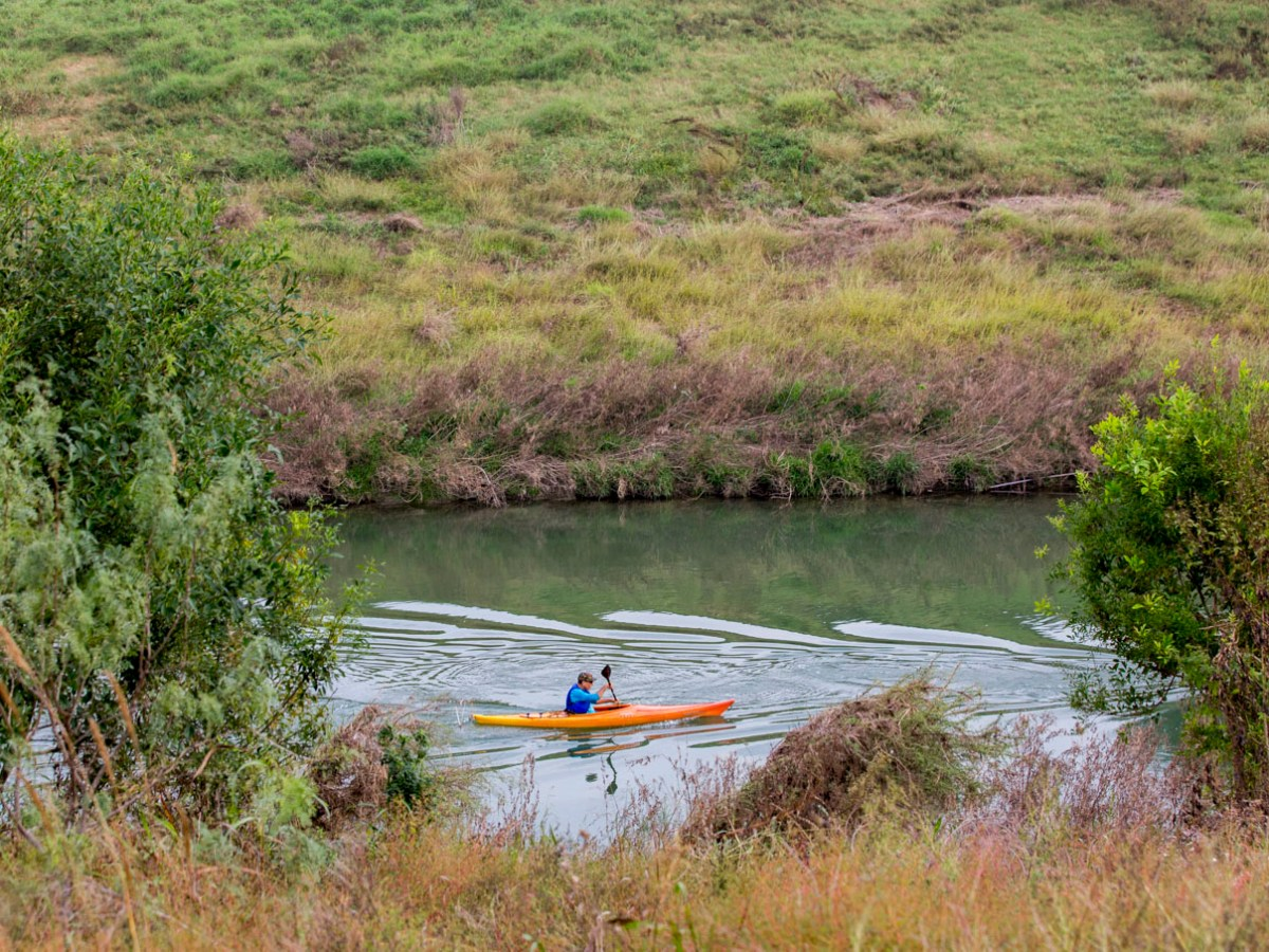 A kayaker paddles along the San Antonio River as part of the River Relay.