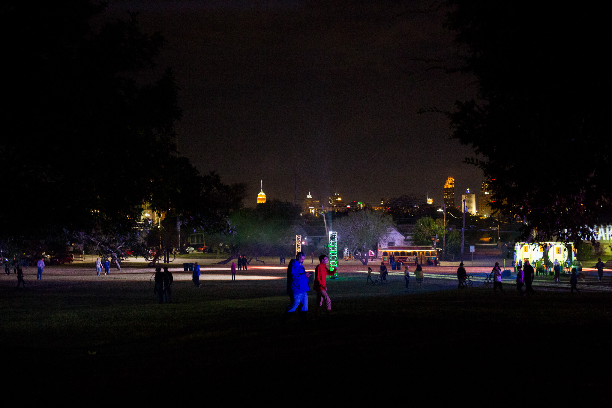 Hundreds of people walk to the many exhibits in Dignowity/Lockwood Park during Luminaria.