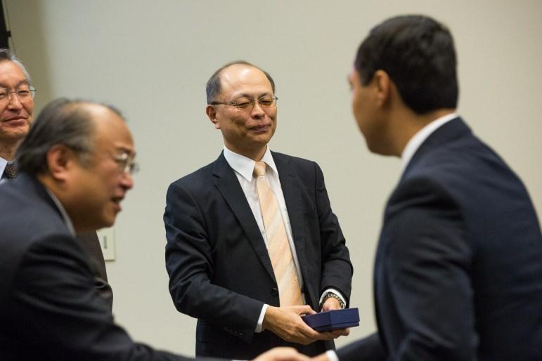 Congressman Joaquin Castro, NAOJ Director Masahiko Hayashi, and Consul-General of Japan in Houston Tetsuro Amano exchange gifts.