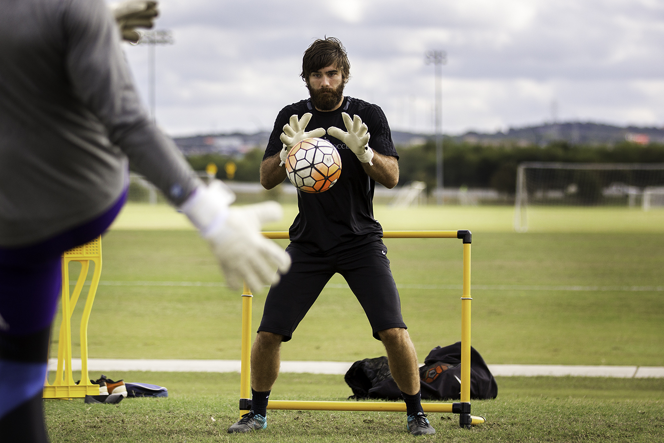 San Antonio FC goalkeeper Matt Cardone warms up during a workout session.