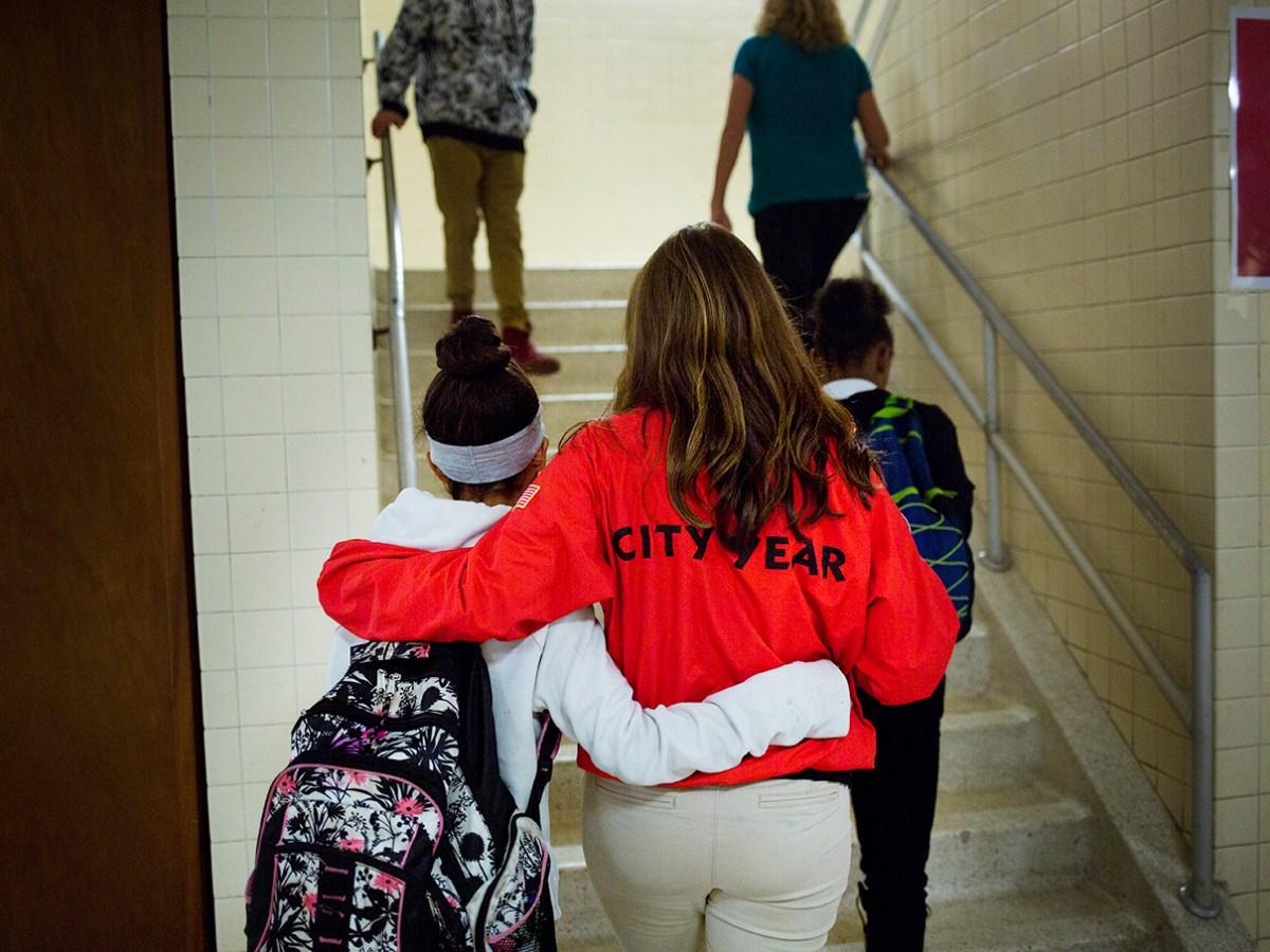 Jessica Rieger embraces a Davis Middle School student.