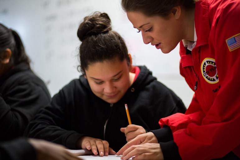 Jessica Rieger helps a student out with an assignment during English class.