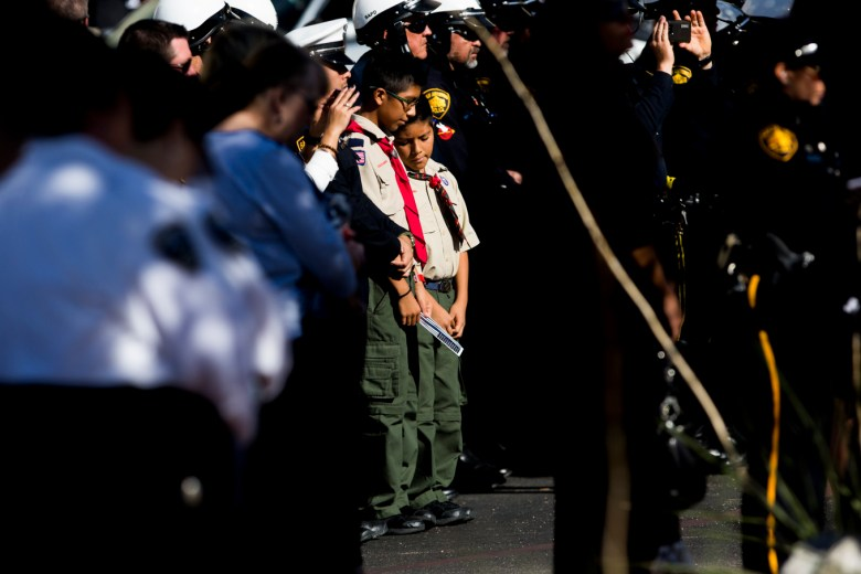 Boy Scouts watch the honors during Detective Marconi's funeral honors.