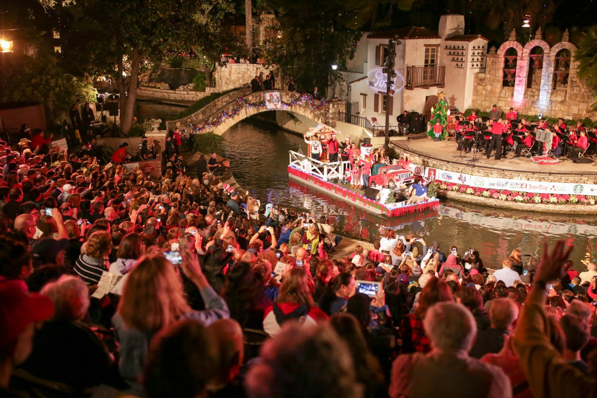 A full house at the Arneson River Theatre look on as floats pass by.