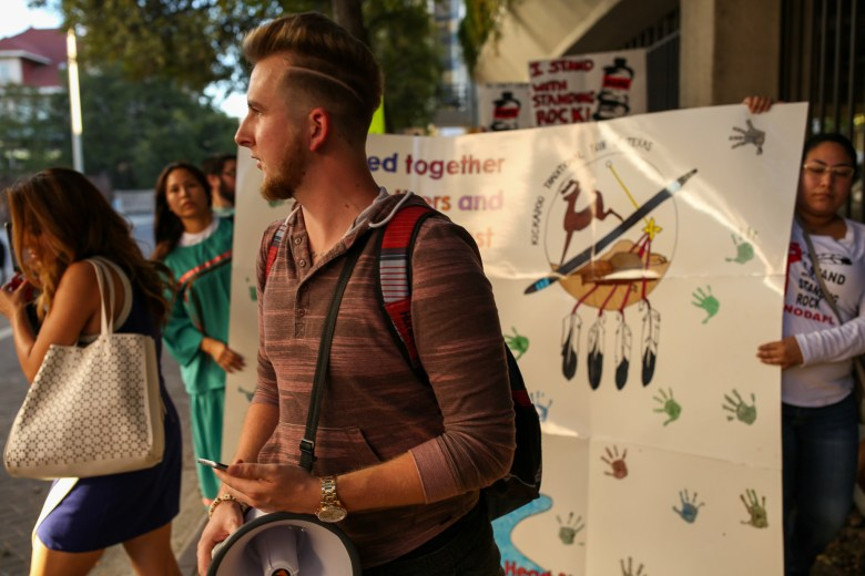 Organizer weight San Antonio Stands with Standing Rock Sawyer Jolly leads the protest through downtown.