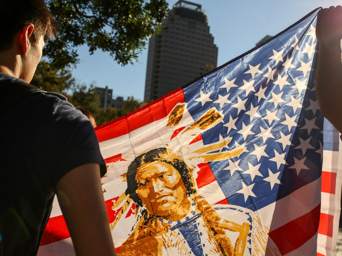 A Native American flag is waved during the march.