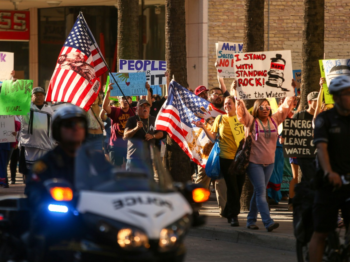 Protestors march down Houston Street as San Antonio Police escorts the crowd.