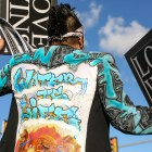 Artist Golden Skyy holds up signs in protest of the Dakota Access Pipeline in a jacket that was made by New Mexico artist Sada. Artist Golden Skyy holds up signs in protest of the Dakota Access Pipeline in a jacket that was made by New Mexico artist Sada.