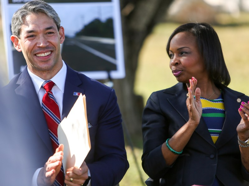 (left) City Councilman Ron Nirenberg (D8) applauds along with Mayor Ivy Taylor at the ribbon cutting ceremony of the completed Hausman Road project.