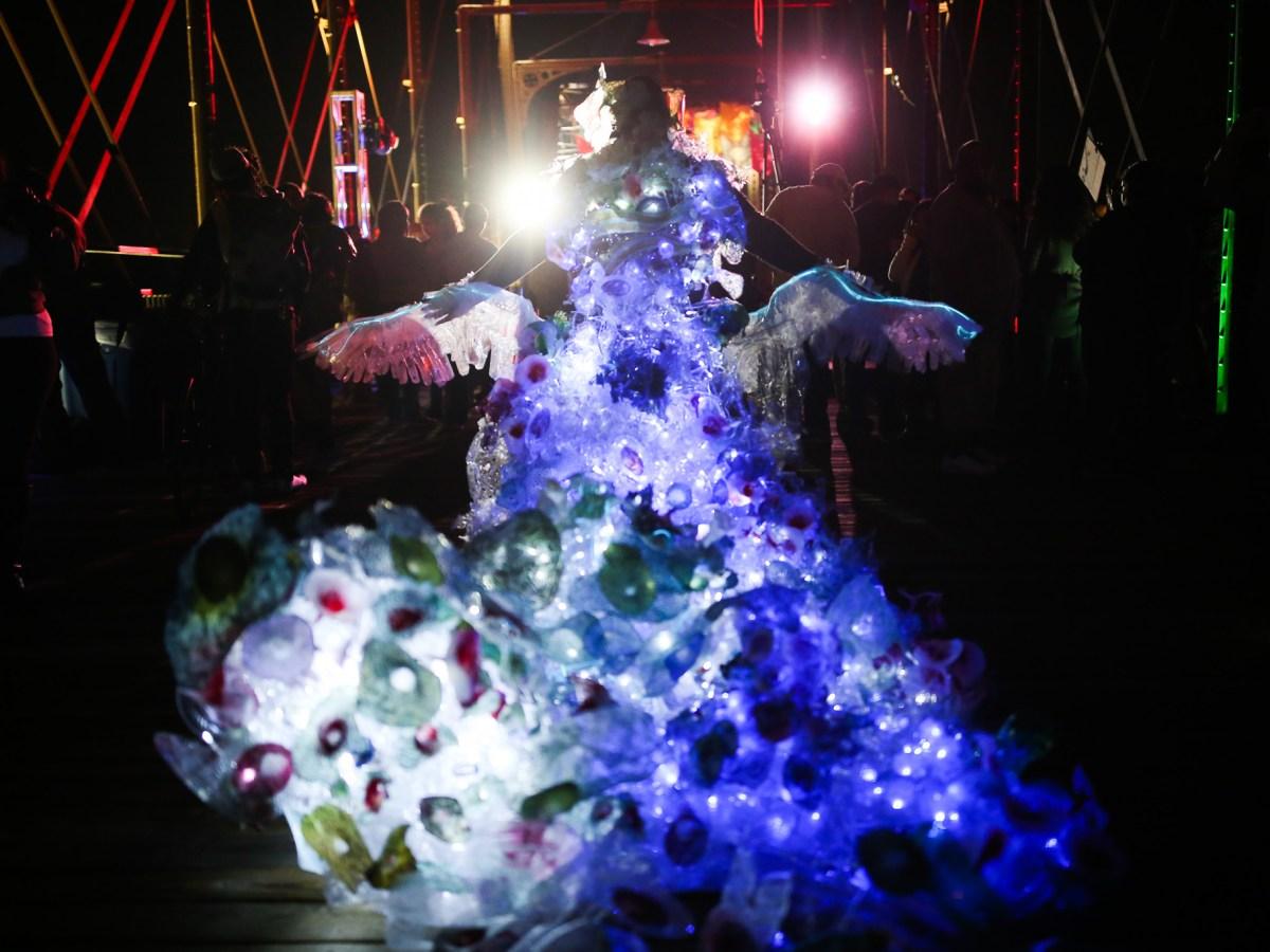 Local artist Margaret Craig walks her installation / performance piece titled 'Albatross' East on the Hays Street Bridge.