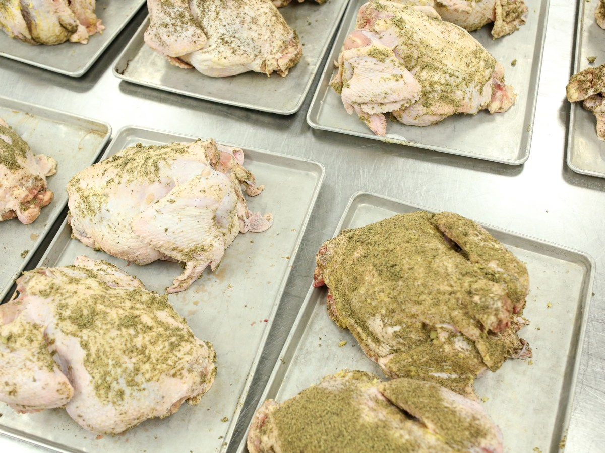 Freshly seasoned turkeys are prepared to be baked and served come Thanksgiving.