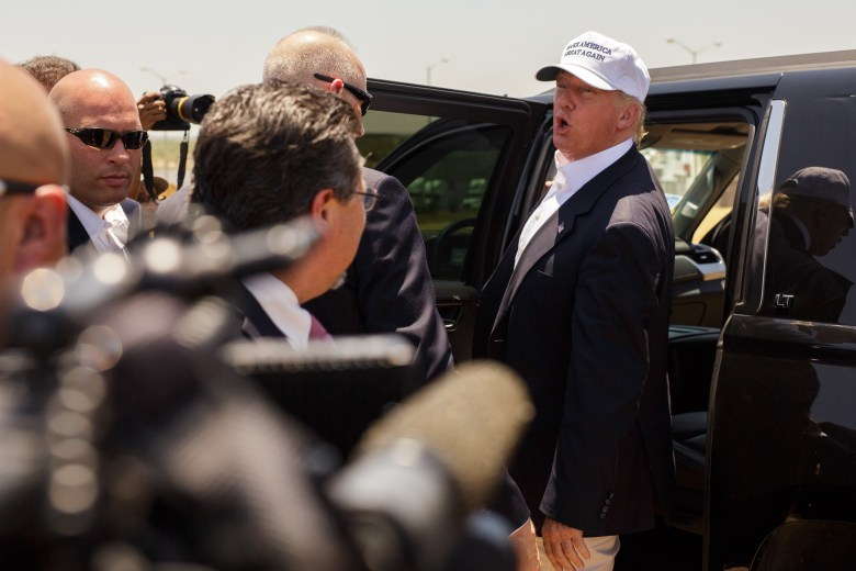 Donald Trump addresses members of the press during a campaign trip in Laredo Texas.