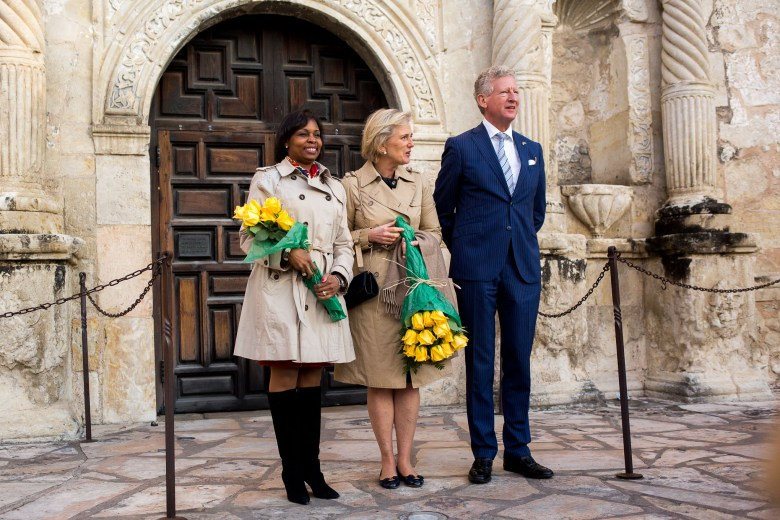 Mayor Ivy Taylor and Her Royal Highness Princess Astrid of Belgium and His Excellency Pieter De Crem pose for a photo in front of the Alamo.