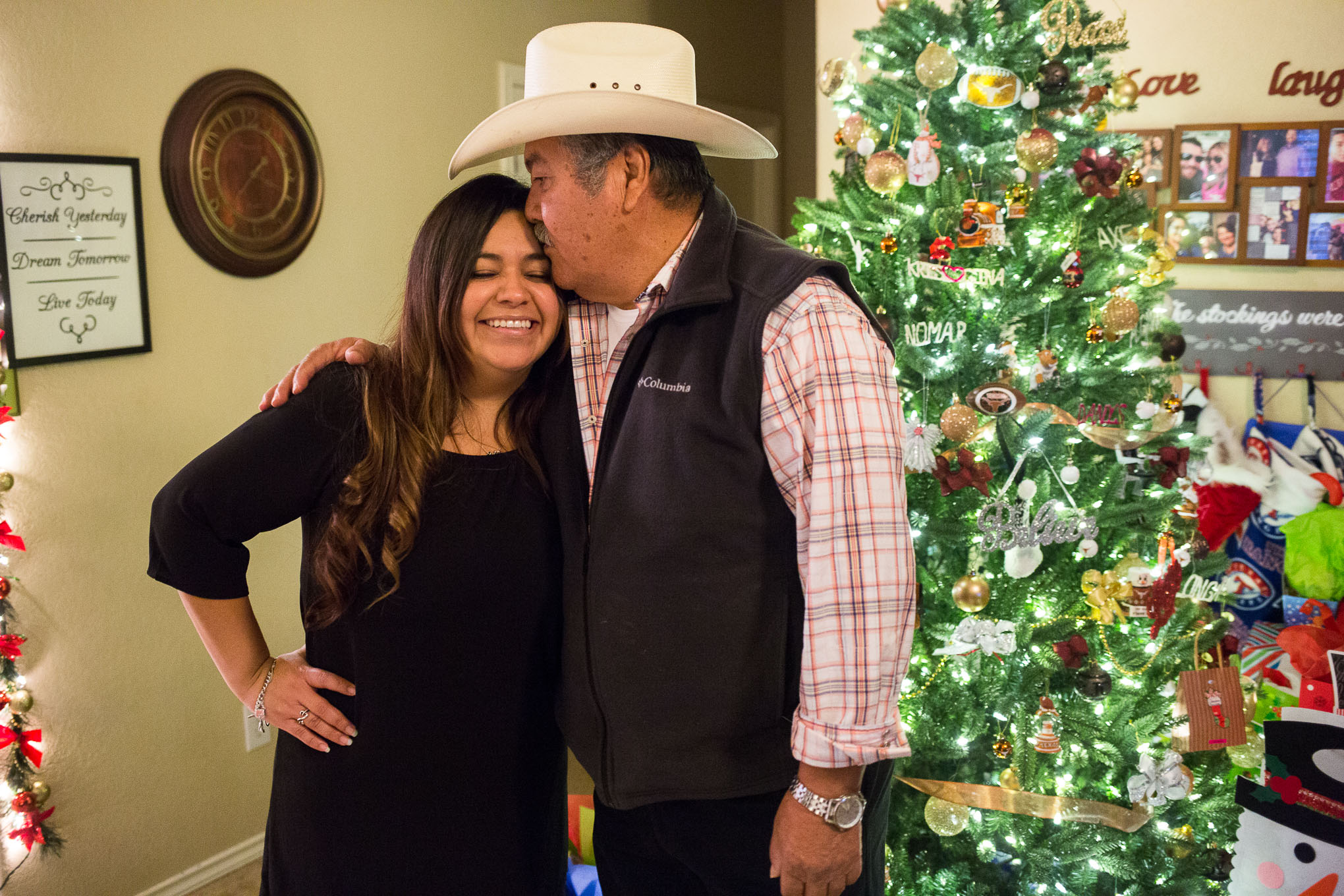 Gina García gets a kiss from her father José García who drove up from Eagle Pass for the graduation.