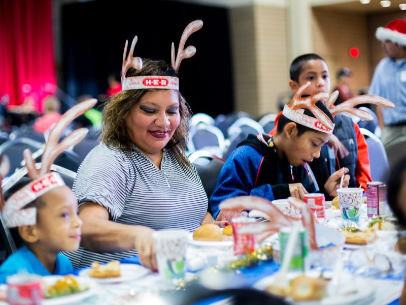 Lucy Diaz, a former nine year H-E-B employee eats with her children. She says she looks forward to it every year because she gets to see her old managers.