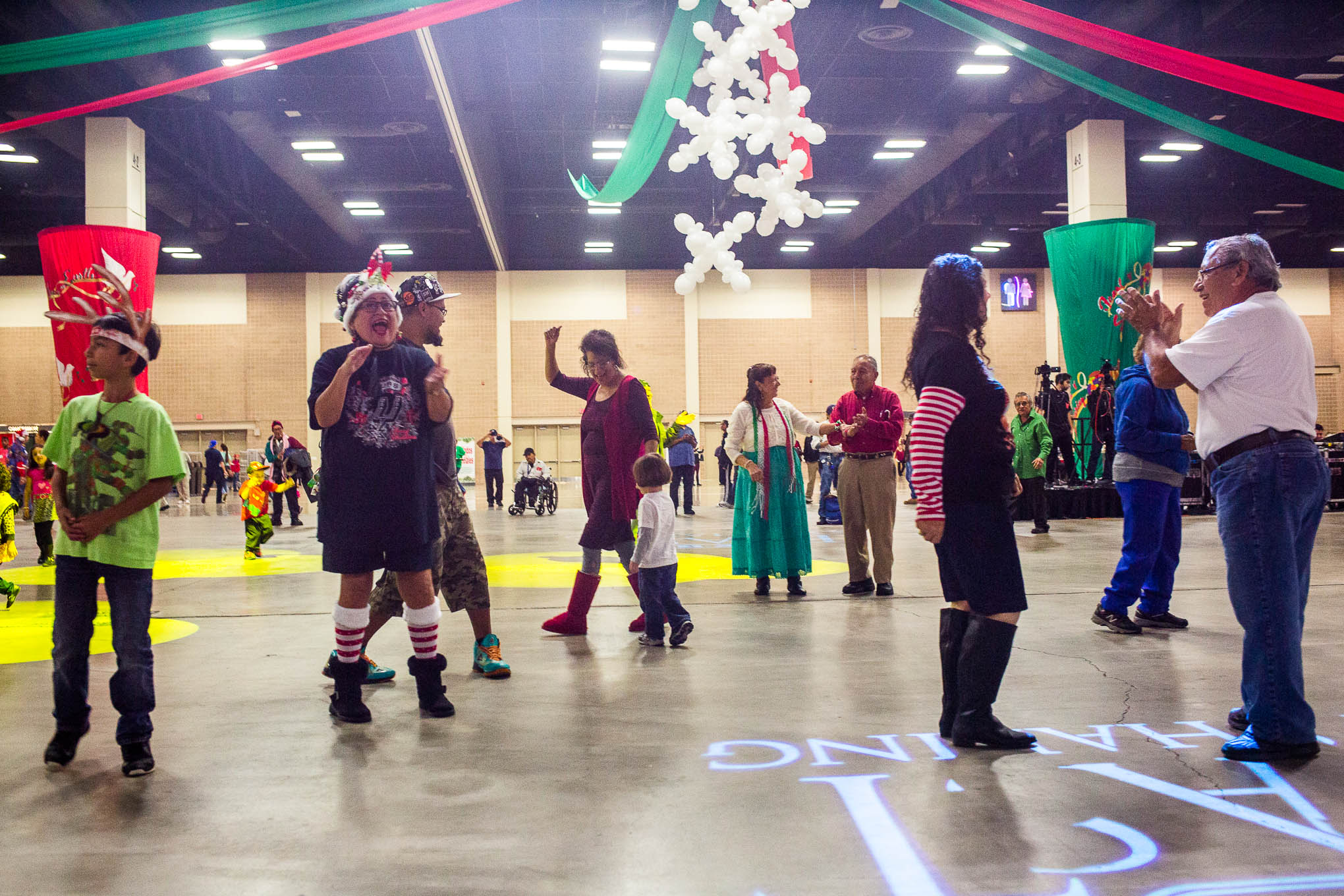 San Antonio community members and volunteers dance to cumbia during the H-E-B Feast of Sharing Celebration.
