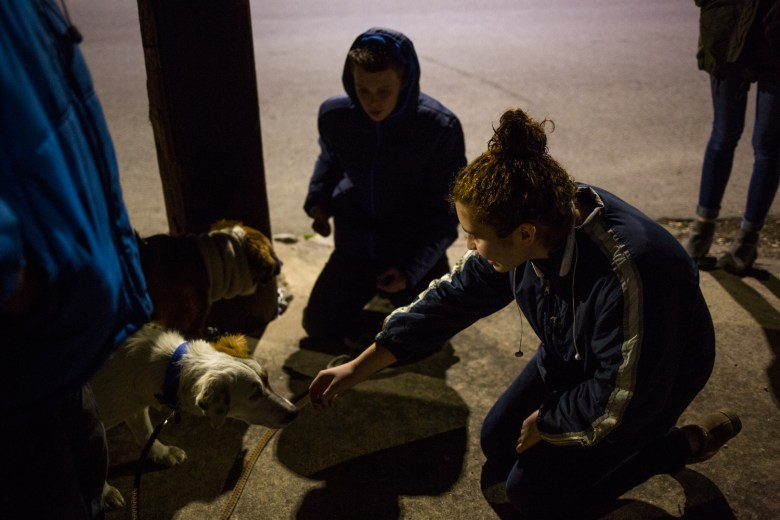 Samantha Garza pets Snowball before heading over to help with the winter clothing give away.