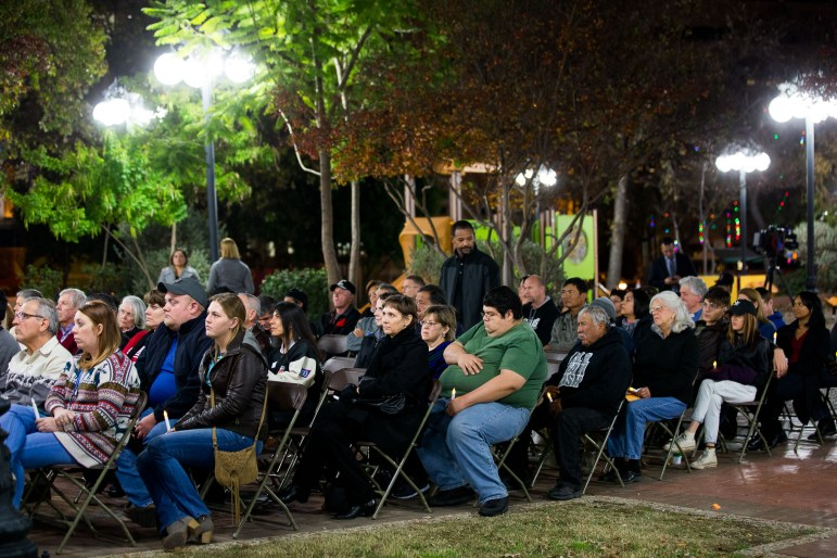 Nearly 80 people gathered at Milam Park to remember those from the homeless population died this year.