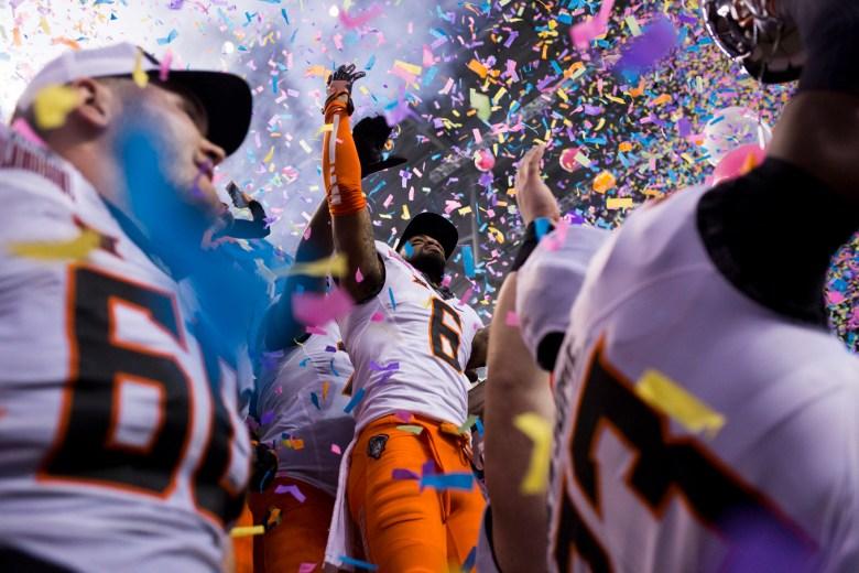 Oklahoma State players celebrate their 38-8 win over Colorado University.