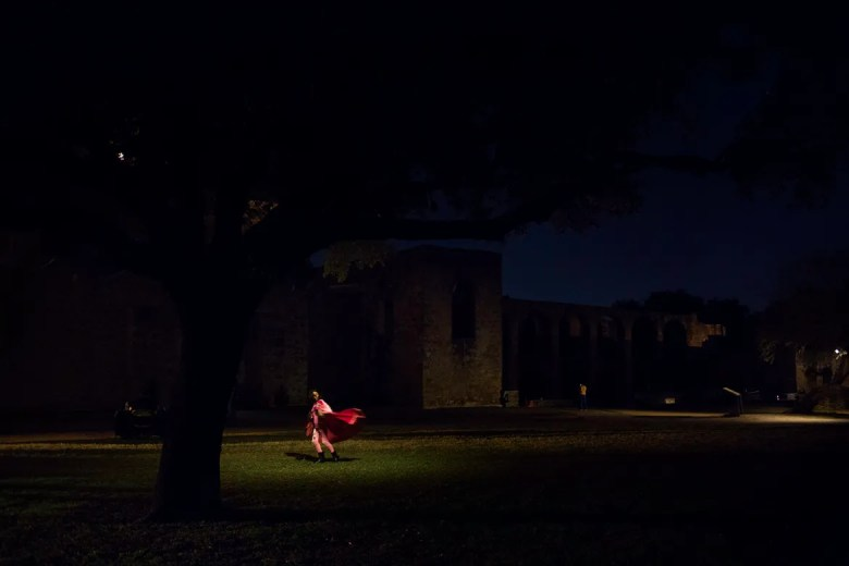 Viviana Ortega, age 8, spins in circles watching her dress flow at Mission San José.