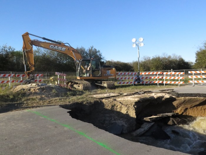 SAWS crews are working to remove water from the sinkhole at 8414 Quintana Road to be able to determine what caused the pipes to break.