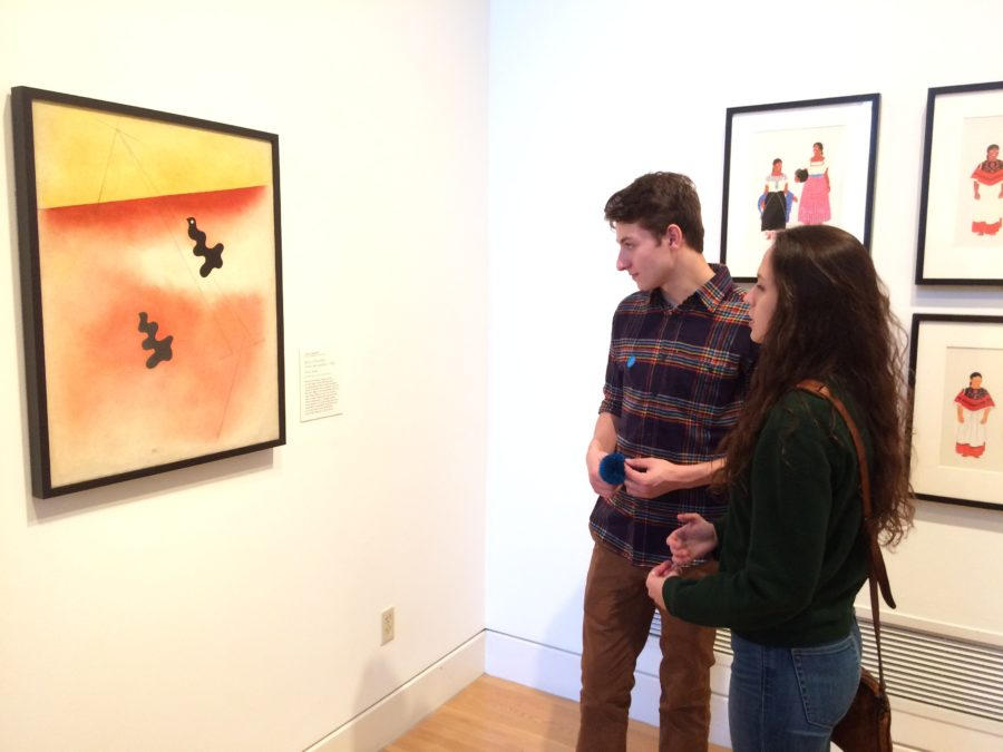 Jake Slater (left) and Noe Barenblat (right) observe Carlos Mérida's painting, Birds of Paradise at the San Antonio Museum of Art.