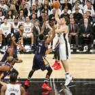 Spurs Center #16 Pau Gasol shoots over New Orleans Defender #1 Tyreke Evans.