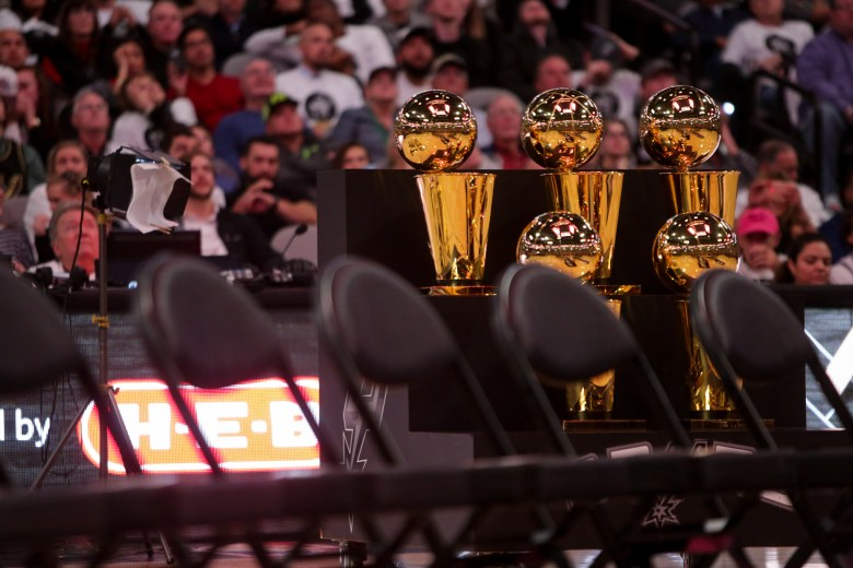 The five Larry O'Brien Championship trophy's all obtained during Tim Duncan's career as a Spur.