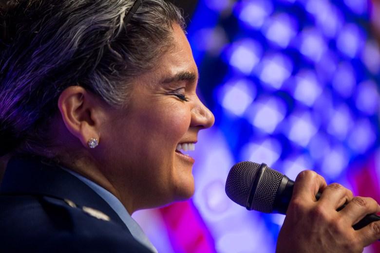 Lieutenant Colonel US Air Force Veteran and Geekdom member Dr. Kat Strus sings the National Anthem.