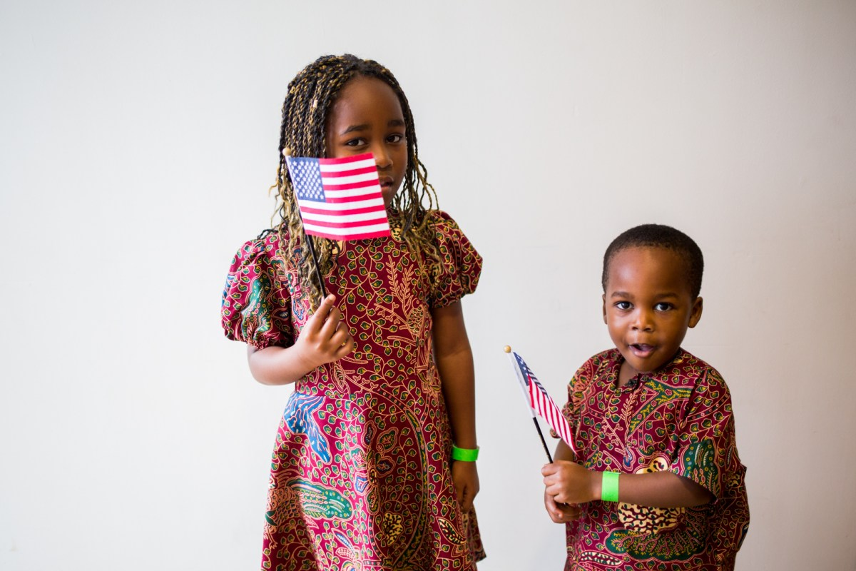 Colby, age 3 from Kenya, poses with his sister after gaining their U.S. citizenship during the DreamWeek Children's Naturalization Ceremony.
