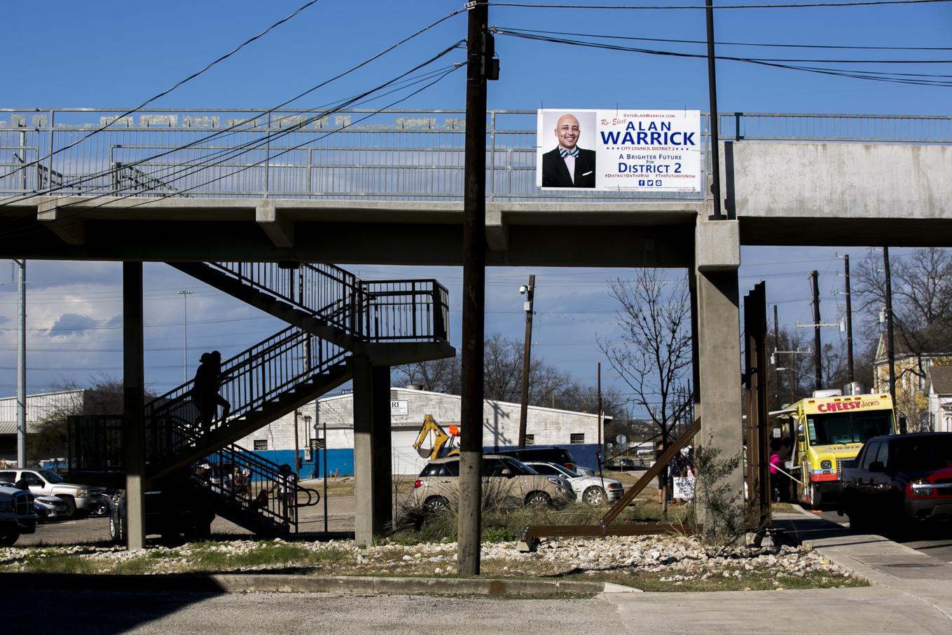 An Alan Warrick re-election sign hangs from Hays Street Bridge.