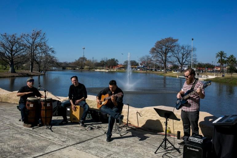 Latino music recording artist James Martin and his band Medianoche perform at Elmendorf Lake Park.