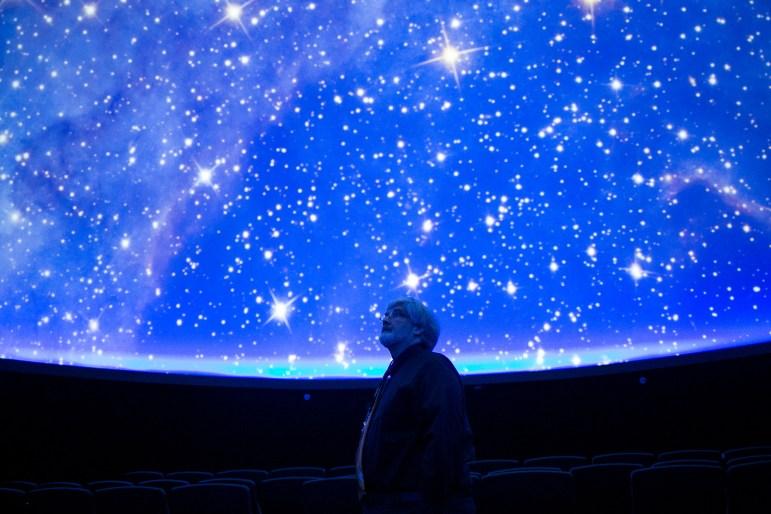 San Antonio College Planetarium Educator Bob Bob Kelley gazes up at a projection of the night sky at Scobee Planetarium.