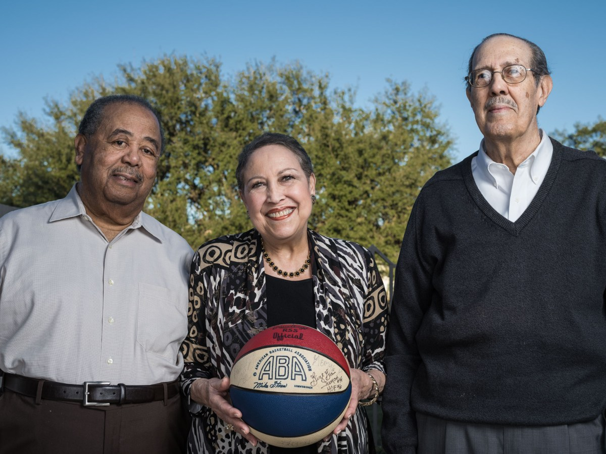 Early investors of the Spurs Doctor James Hadnott, Aaronetta Pierce, and Joe Pierce stand for a portrait.