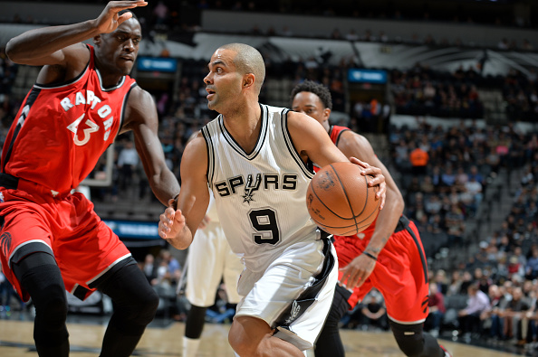 Tony Parker #9 of the San Antonio Spurs drives to the basket against the Toronto Raptors on January 3, 2017 at the AT&T Center in San Antonio, Texas.