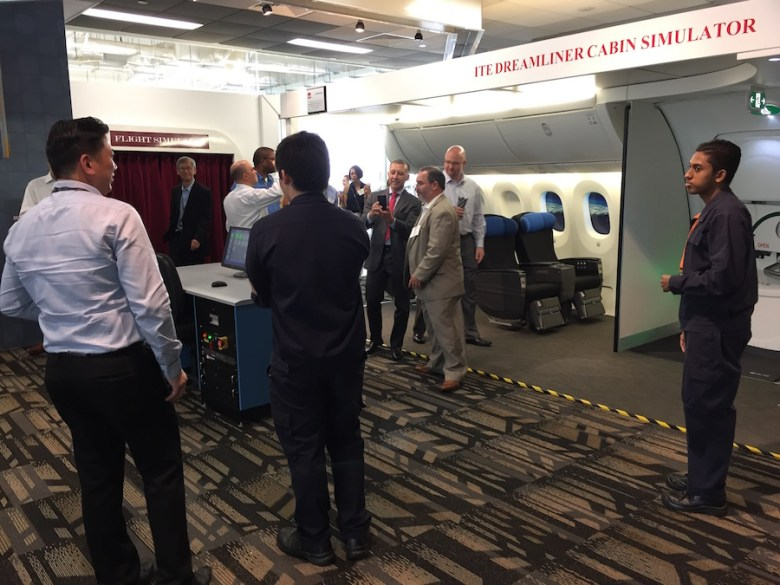 Instructors at Singapore's Institute for Technical Education College Central show Texas educators a Boeing Dreamliner learning laboratory.
