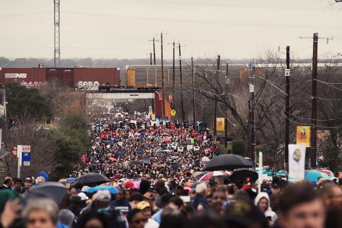 Thousands of people march up MLK Drive as part of the 2.75 mile march.