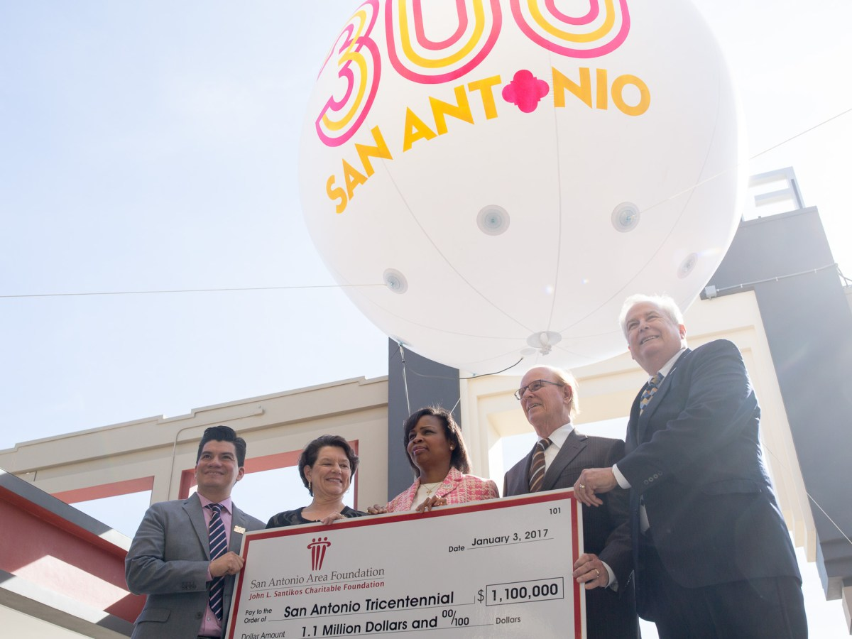 (From left) Tricentennial Commission CEO Edward Benavides, Witte Museum President and CEO Marise McDermott, Mayor Ivy Taylor, Bexar County Judge Nelson Wolff, and President and San Antonio Area Foundation President and CEO Dennis Noll hold the check of the gift to be given to the San Antonio Tricentennial Commission.