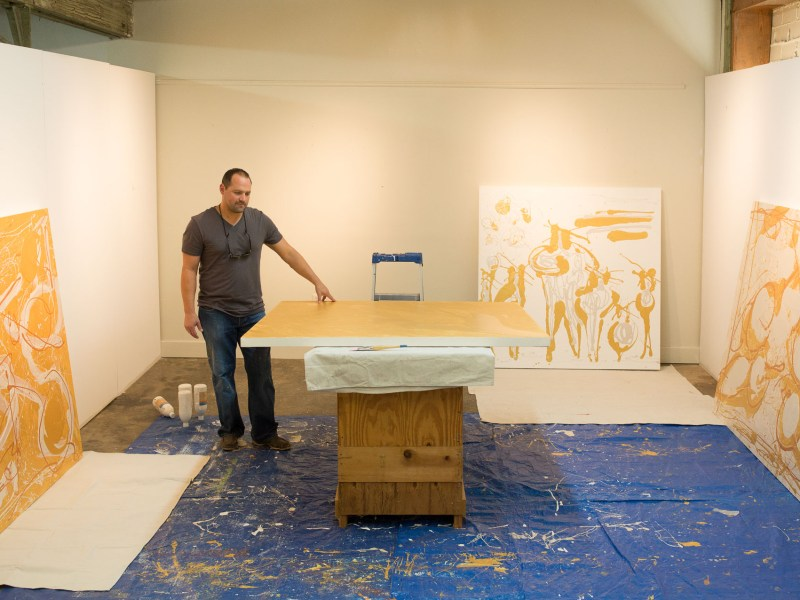 AJ Rodriguez looks over a piece of his new his new body of work titled 'Figuras'.