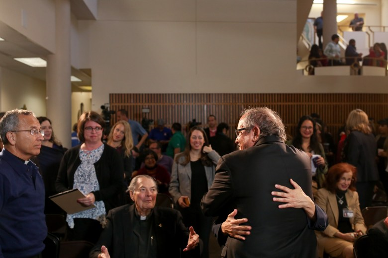 Auxiliary Bishop-elect Michael Joseph Boulette embraces with friends, colleagues, and community members following the announcement.